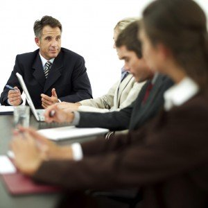 Businessman Conducting a Meeting with His Staff